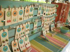 tiny clothes pins to hold jewelry cards with bead info sticker on card