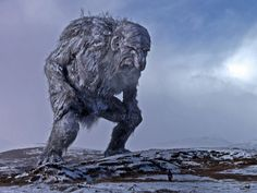 A classic jötunn - and yes, that's a person standing in front of him