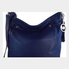 Authentic Michael Kors Navy Lrg TZ Shoulder Bag Megan large TZ shoulder bag. Silver hardware leather tassel michael Kors hang tag . Zip top closure, exterior button pocket,interior  zipper pocket. 12 h x 15.5 L x 2 d MICHAEL Michael Kors Bags Shoulder Bags