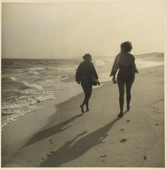 Two women walking on beach from Camping trips on Culburra Beach by Max Dupain and Olive Cotton