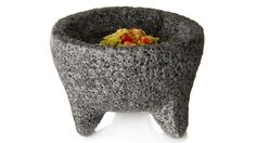"The molcajete is a kind of mortar made of volcanic stone, with a hand called ""tejolote"". It is used to grind the ingredients in sauces or condiments like achiote.  - ""I once read that if tortillas are the heart of Mexico, then the salsas are the blood, and I completely agree—especially salsa made in a molcajete"".  - Marcela Valladolid."