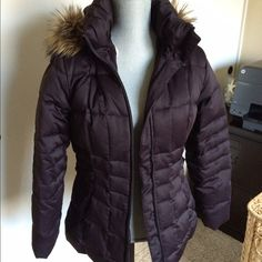 Calvin Klein Brown Puffer Jacket: Small Feather down puffer jacket with removable hood. Hardly worn! Hardly need it in mostly warm Southern Cali. It's between a medium and heavy weight. Many pockets inside, two with zipper. Zipper pockets outside. Very warm!  Make an offer! Calvin Klein Jackets & Coats Puffers