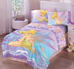 $34.95-$50.00 Baby Disney Tinkerbell Pixie Dust Twin Comforter - Do you believe in fairies? You can with Disney Tinkerbell Pixie Dust bedding.  This bedding is great for juvenile through teen room settings. The product is cotton rich which makes it soft and easy to care for.  Choose from twin or full sizes in sheets and comforters.  Add pillowcases, valances and plush pillows to complete the loo ...