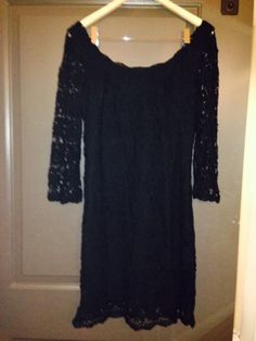 Beautiful White House Black Market Black Dress, Size 12, RETAILS $198.00  Beautiful and Sexy White House Black Market Sophisticated long sleeve Black Dress with a 100% cotton overlay that gives it that lacey look!!! Adds a lil pop.   Perfect for a cocktail party. Also can be worn to work under a jacket and take the jacket off and ready to party.  100% Cotton, Lining 100% Cotton.  Fits: True to size & Very Slimming New W/ Tags