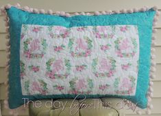 Quilted pillow sham with reclaimed vintage pom pom trim