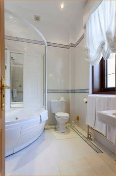 Different factors must be taken into account when you are conducting a master bathroom remodel than when remodeling some other bathroom. There are two... Bathroom Floor Plans, Bathroom Flooring, Bathroom Fixtures, Small Bathroom, Master Bathrooms, Glass Blocks, Corner Bathtub, Improve Yourself, Vanity
