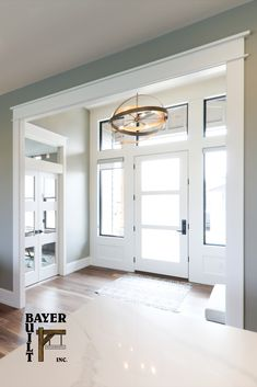 We know how important natural light is, especially during one of our Midwest winters. This entry is light and bright 365 days of the year and just one of many front door solutions we have for your home. Exterior Doors, Entry Doors, Entrance, Garage Doors, Entryway, Wood Grain Texture, Natural Light, Decorative Accessories, Laundry Room