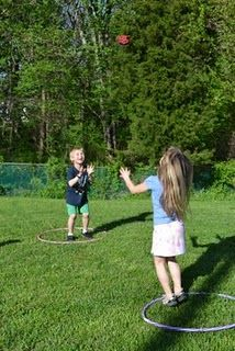 To play, each player stands in their own hula hoop and attempts to toss the bean bag into the other hoop.  The defender tries to block the bean bag from landing inside the circle, by using their hands, feet, head, etc. to deflect it.