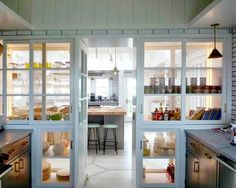 Sardar Design Studio / See-through built-in pie safe pantry walls  Interesting..I am not neat enough to want everything on display..but love the look!..***