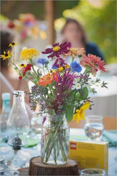 colorful wildflower centerpiece / http://www.himisspuff.com/rustic-mason-jar-wedding-ideas/3/