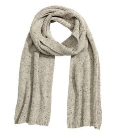 Gray melange. Scarf in a soft rib knit. Size 10 1/2 x 72 3/4 in.
