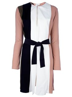 Brown dress from Vionnet featuring a tricolour panelled design, a round neck with two pintucks to the top, a central vent to the front, long sleeves, pleats and a fabric waist belt.