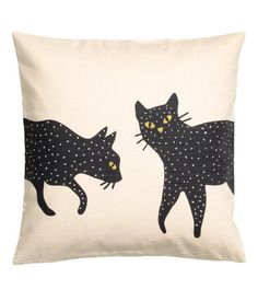 Natural white/cats. Cushion cover in woven cotton fabric with a printed motif and details embroidered in glittery thread. Zip at one side.