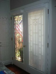 Smith and noble i think simple shades on the french doors for Roller screens for french doors