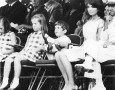 youngfirstlady:  The restless tot is John Kennedy, son of the late President, and he is admonished by his mother Jacqueline Kennedy, weeps, and settles back to watch further proceedings.