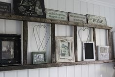 Using an old ladder for display. Cool. Basement, maybe over fireplace, or on wall