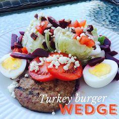 Turkey Burger Wedge Salad! ~ 380 calories 1 lean Jennie-O Turkey Burger (season w/ garlic powder, salt & pepper) 1/4 head of iceberg lettuce 2 tbl. turkey bacon bits 2 tbl. feta cheese 1 hard-boiled egg Tomato Sliced pickled beets  Walden Farms Calorie-free Blue Cheese dressing!   Enjoy!  @fitgirl_shelby #fitgirlsguide