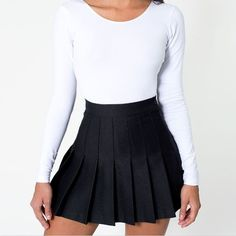 "Pleated tennis skirts are totally trending these days! Why pay $54 at American Apparel when you can buy the exact same American Apparel skirt for less than half the price?! Check out our other colors too! Brand: American Apparel Color: Black XS: Waist: 23"" Length: 13"" S: Waist: 25"" Length..."