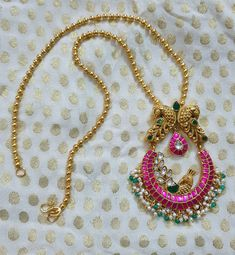 An unusual pair of Kundan earrings, accented with Nakash handmade gundus, finished off with jade bead hangings. Gold Temple Jewellery, Silver Jewellery Indian, Indian Necklace, Gold Bangles Design, Gold Jewellery Design, Gold Jewelry Simple, Simple Necklace, Amrapali Jewellery, Gold Mangalsutra Designs