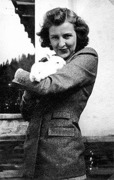Eva Braun with two little bunnies on the Berghof terrace, 1942.