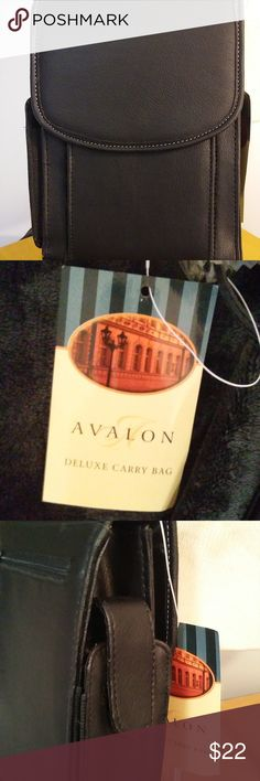 """Cross Body Avalon Deluxe Carry Bag/Wallet/Photo NWT - BLACK CROSS BODY - Avalon - DELUXE CARRY BAG Comes with a Check holder and attached key chain as well as a small 2 picture photo holder New with tag, Never used. Has many compartments, snap closure front, side pocket and zipper back pocket MAESURES : 8""""  TALL X 6"""" WIDE STRAP IS  21"""" LONG Fits nicely over the shoulder NO ISSUES OR DAMAGE Avalon Bags Crossbody Bags"""