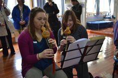 Emily M. '17 and Maddie S. '14 learn to play the Hulusi during a music lesson at SMIC Private School.