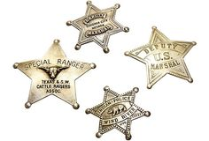 Collection of four vintage sheriff badges. Includes Deputy Marshal of Nevada, Deputy Marshal of the U.S, Special Ranger of the Texas Cattle Raisers, and Indian Police of Wind River, WYO.