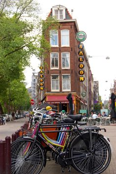 """De Saloon  A row of bicycles outside of """"De Saloon"""" at the intersection of Korte Leidsedwarsstraat (right) and Lijnbaansgracht (left)."""