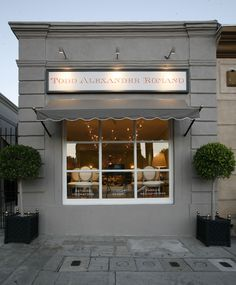 Love the awning and planters