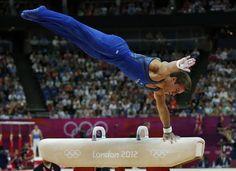 Sam Mikulak dismounts the pommel horse during men's Olympic gymnastics qualifying in London as part of Team USA.