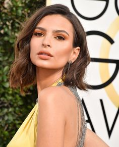 Typically, orange-colored eye shadows are the makeup equivalent of granny panties—you'd never think of wearing them on a date. That is, until we saw Emily Ratajkowski's monochromatic makeup at the Golden Globes. With varying shades of apricot and peach on her eyes, cheeks, and lips, we've never seen orange look so sexy. The secret? Keeping things sheer, not saturated. That means blending the shadow into a wash of color across the eyes (makeup artist Hung Vanngo layered multiple products…