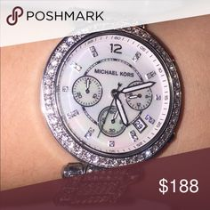 Silver Michael Kors watch (includes original box) Stunning silver michael kors watch. The only flaws include a scratch on the face and one or two crystals missing on the band (you would not notice this unless you were looking for it) Originally paid $375 Michael Kors Jewelry