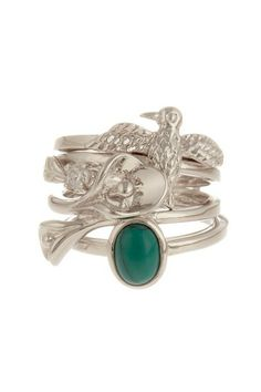 "Beyond Rings  Cornucopia Stack Ring Set  - Rhodium plated bird ring, bypass lily ring, bezel set oval turquoise ring and prong set CZ and leaf ring  - Set of 4  - Approx. 0.75"" L x 0.75"" W ring face  $88.00"
