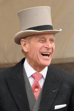 Prince Phillip in his top hat and actually laughing!