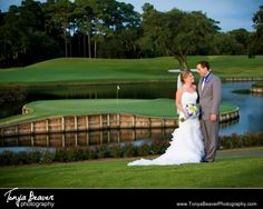 A bride and groom formal overlooking the 17th hole at the stadium course, TPC Sawgrass.   TPC Wedding Photos - Ponte Vedra Wedding Photos -  Tonya Beaver Photography 031