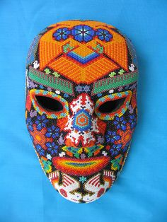 Huichol Man Mask - An orange colored eagle tops the forehead of this beaded mask made by a Huichol artist of Mexico City