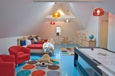 The easiest way to make a space look bold and fun is through color. This attic looks particularly friendly because of the shapes used throughout. Turn The Attic Into A Perfect Play Area For The Kids - 25 Inspirational Design Ideas