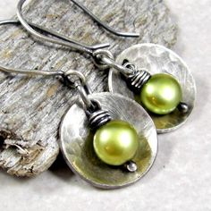 Sterling Silver has been cut, domed and hammered for texture. A chartreuse freshwater pearl is wire wrapped in torch balled fine silver and dangles from