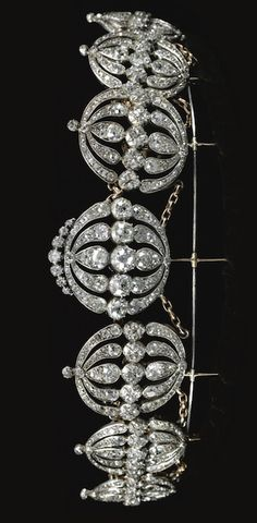 Each oval open work plaque set with circular-cut, old mine and rose diamonds, together with a tiara frame and later chain links, mounted in silver and gold, tiara frame measuring approximately 385mm;