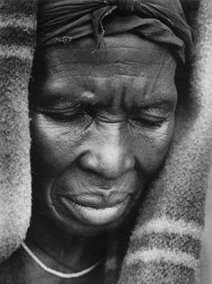 http://tiny.cc/yjxh62tv for more pictures, African Zulu woman grieving-photographed while she was sitting at the graveside after her husband had been buried.