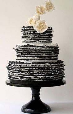 black and white ruffle cake. imagine with red roses.