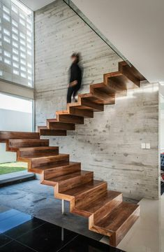 Modern and linear wooden staircase image, with an essential design, without railing - modern staircase ideas