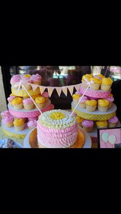 Ombré pink and yellow smash cake