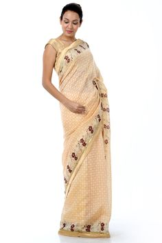Dress in splendour with this gorgeous yellow sari, fashioned in kosa silk with cotton blend for a regal appeal. This designer creation is enriched with a beautiful floral border accented with exquisite sequence detailing. It comes with a contrasting blouse piece.