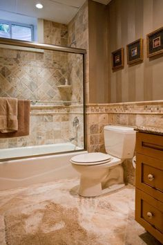 Bathroom,Appealing Bathroom Design Ideas With Natural Stone Tile Bathroom  Combine With Stripes Wallpaper Featuring Glass Shower Enclosure And  Aluminum Towel ...