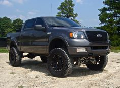 charcoal grey lifted ford f-150 truck