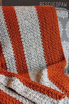 This Cozy Blanket will be sure to get you in the mood for the season of all things pumpkin! Crochet Pattern by Rescued Paw Designs!