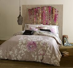 HIS KALEAH FLORAL DUVET COVER IS ADORNED WITH NATIVE FLOWERS, TRANSPORTING YOU TO THE ULTIMATE PEACEFUL GARDENHand-painted watercolors in orchid, elderberry and lilac bloom into native flowers on this Kaleah floral duvet cover. Flowing into white, botanicals and vines, they climb up her front side of dove grey. A refined chevron pattern reverse in pebble and white, invites you to climb in to this floral duvet cover. Set includes duvet and shams.