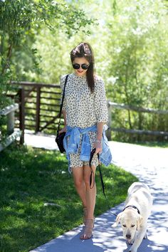 leopard dress with a denim jacket around the waist