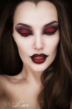 A somewhat simple red and smokey black eye with a black lined lip for a sultry Halloween Makeup Look